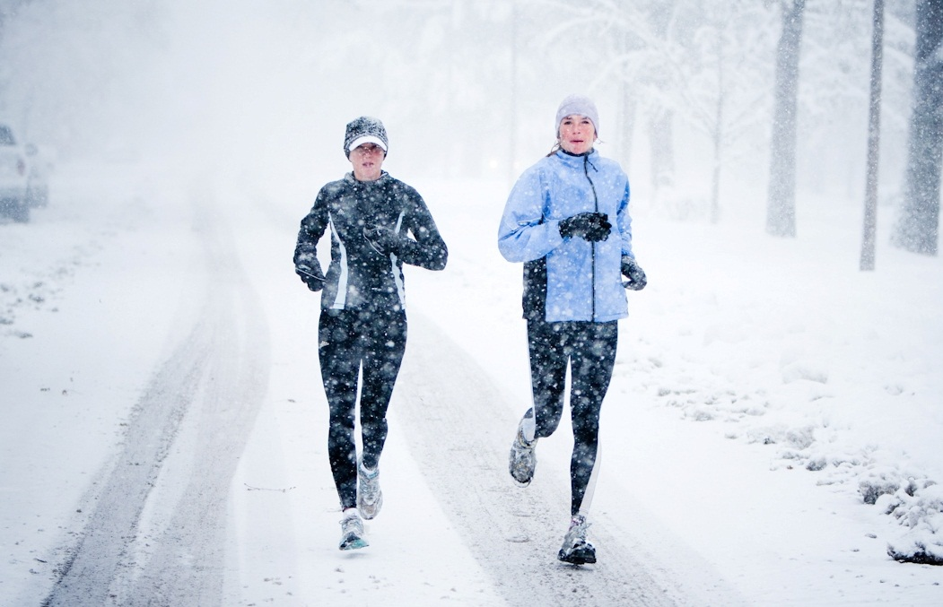 Kara Roy and Jennifer Lee and run down Mountain Avenue in a snowstorm.