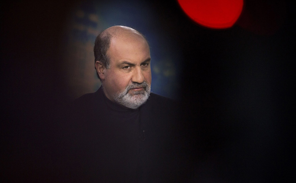 "Nassim Nicholas Taleb, New York University professor and author, pauses during a Bloomberg Television interview in New York, U.S., on Tuesday, Feb. 19, 2013. President Barack Obama's administration has perpetuated the causes of the 2008 financial crisis by failing to break up the largest U.S. banks, according to New York University's Taleb, author of the book ""The Black Swan."" Photographer: Scott Eells/Bloomberg *** Local Caption *** Nassim Nicholas Taleb"